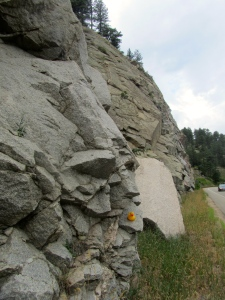 Road cut through steep mountain in Boulder Canyon