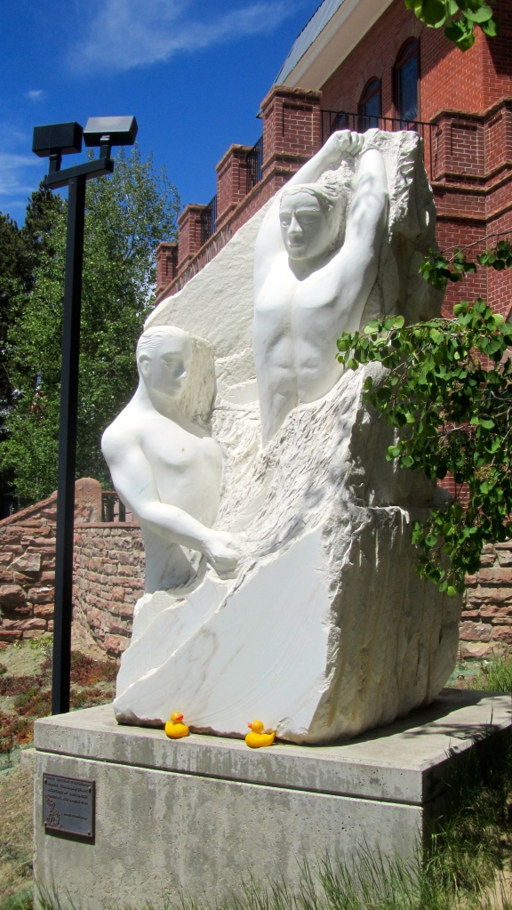 Marble mining statue