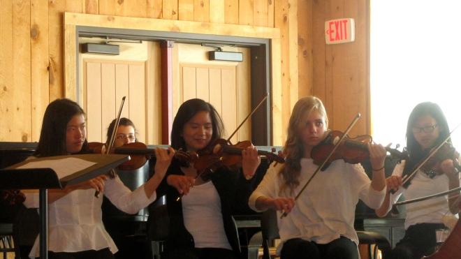 Greer is playing her violin