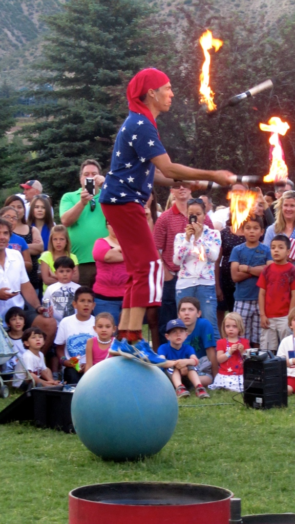 Juggling fire while standing on a ball???