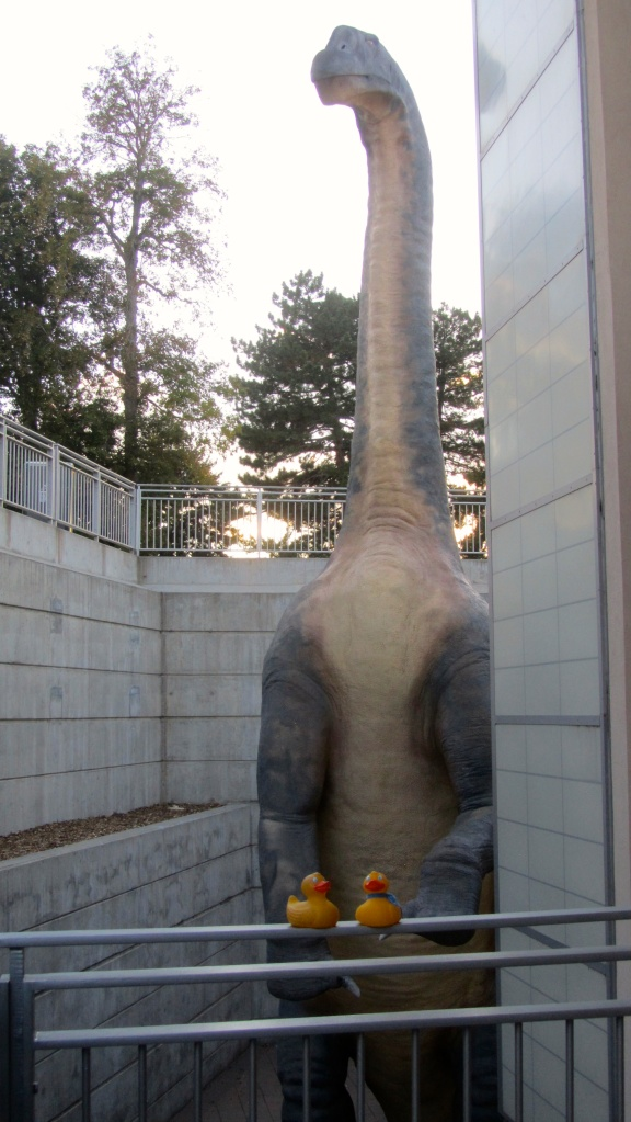 Dinosaur by elevator to parking garage