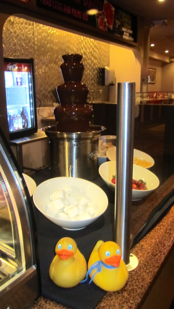 Chocolate fountain with marshmallows, strawberries and more