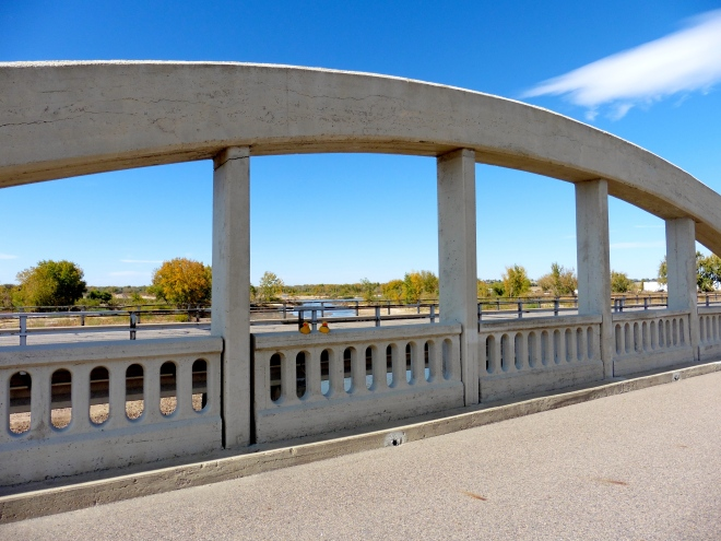 Looking through an arch and over the newer road for motorized traffic, to the South Platte River