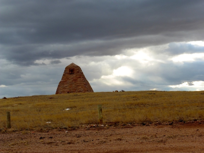 Monument in Wyoming with storm clouds