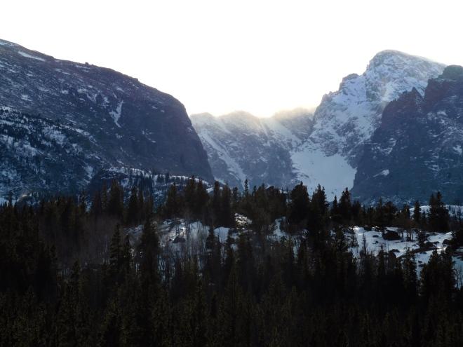 Snow swirling around the mountain peaks.