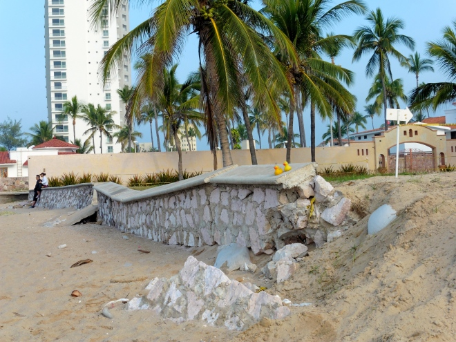 Wall between beach and resort