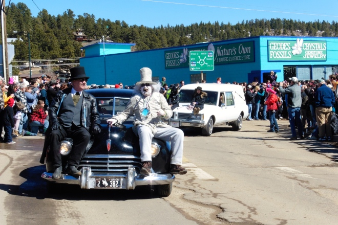 Hearse with live people on hood
