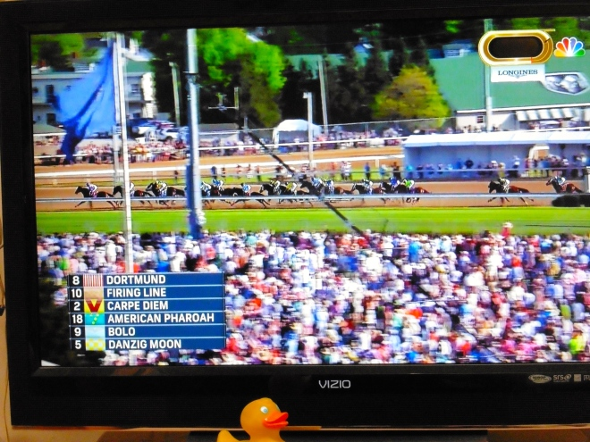 So many spectators.   American Pharaoh is in 4th place