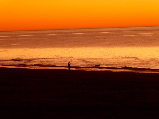 Beautiful Indian Ocean sunset with a lone fisherman