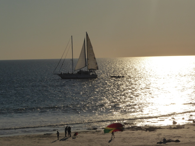 Sailboat with people on beach