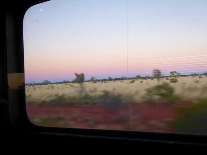 Earth is red approaching Alice Springs this morning. Blurry since train is moving quickly