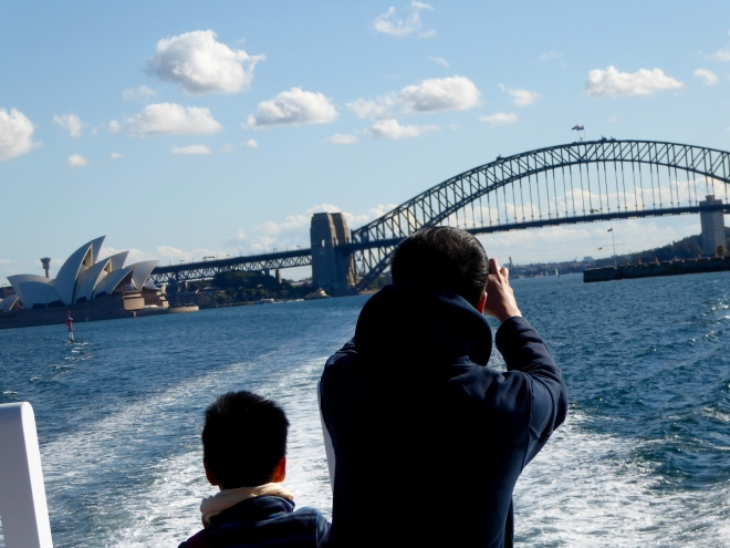 Leaving Sydney Harbor, we look back at the Sydney Opera House and the Sydney Harbor Bridge