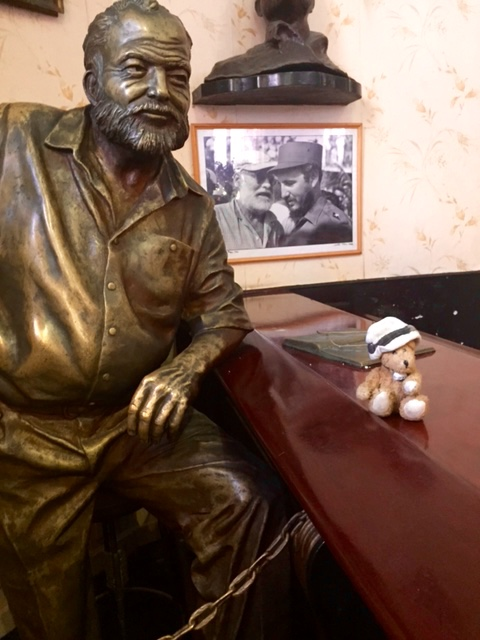 Channel with statue of Ernest Hemingway in El Floridita in Havana