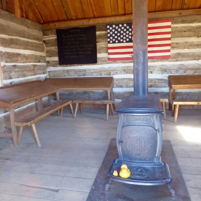 Inside the school house. Heat supplied from a wood burning stove.