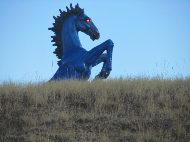 Red eyes on blue horse at Denver International Airport