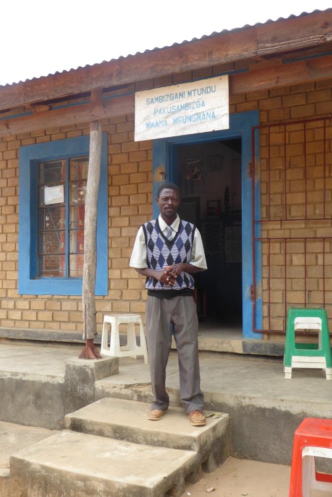 Preschool teacher in front of classroom