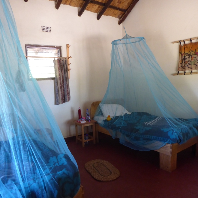 Our room, with mosquito netting over beds