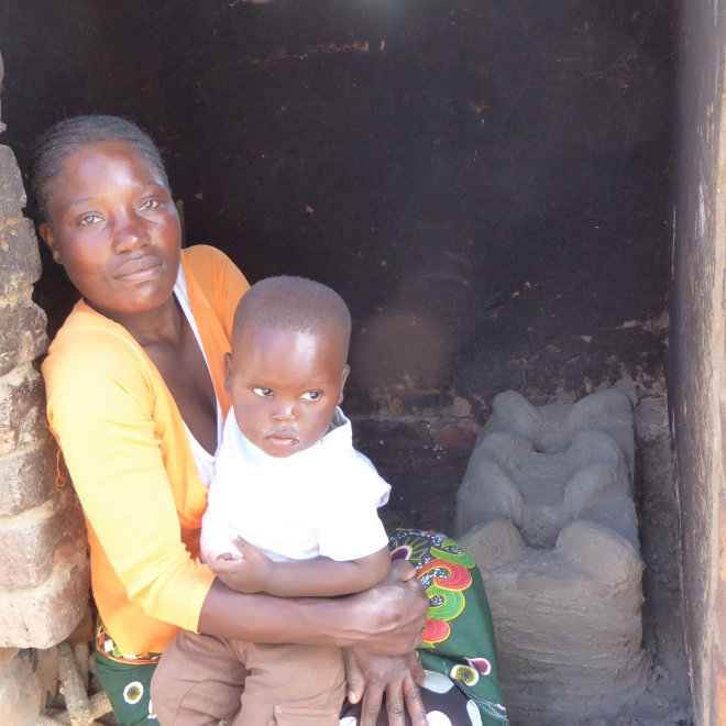 Mother with her child by her new stove