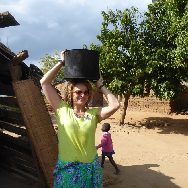 Denise carrying water