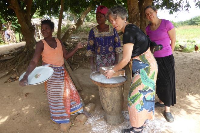 Deborah sifting cassava
