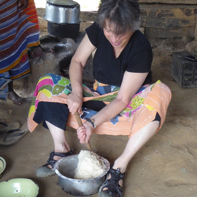 Deborah stirring cassava