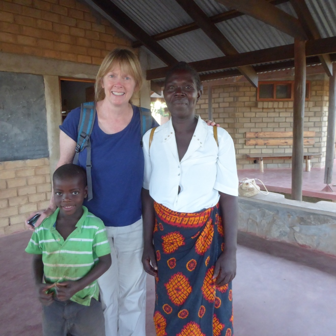 Jenny with adult student and a teachers child