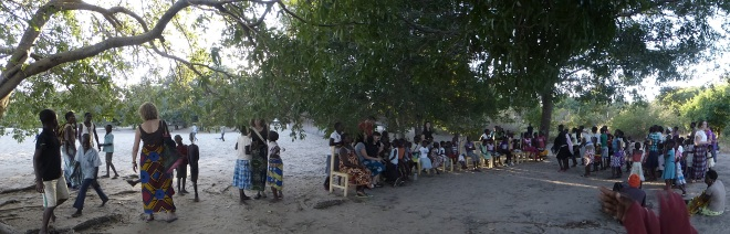 Many people on beach of Lake Malawi