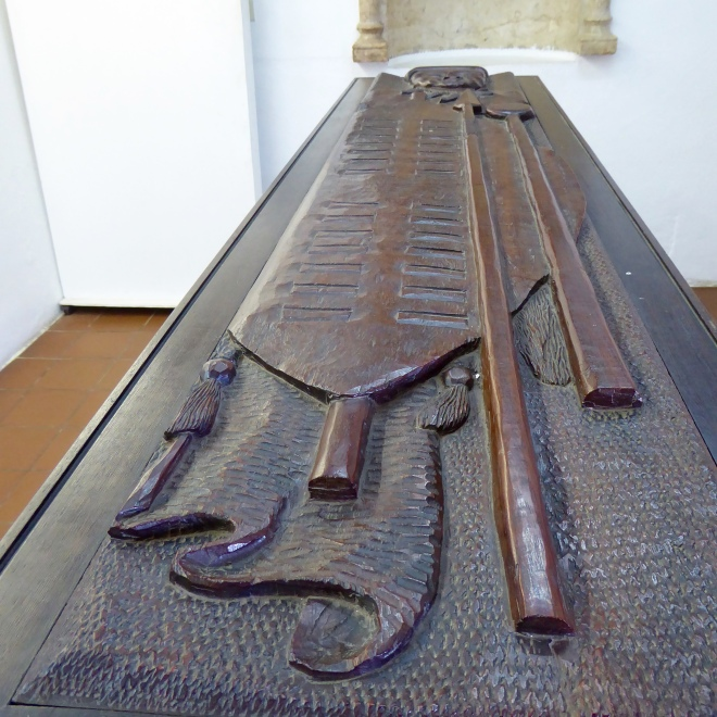 Carved coffin lid