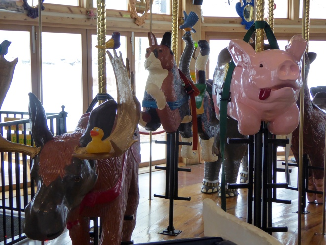 I am on the moose, near a pink flying pig.