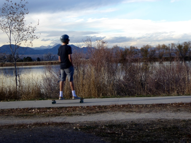 Skateboarding around the lake