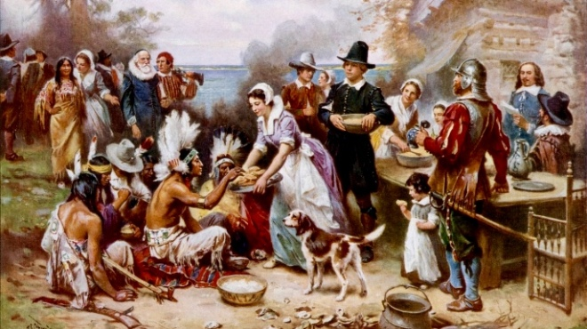 American pilgrims and Native American Indians sharing and celebrating