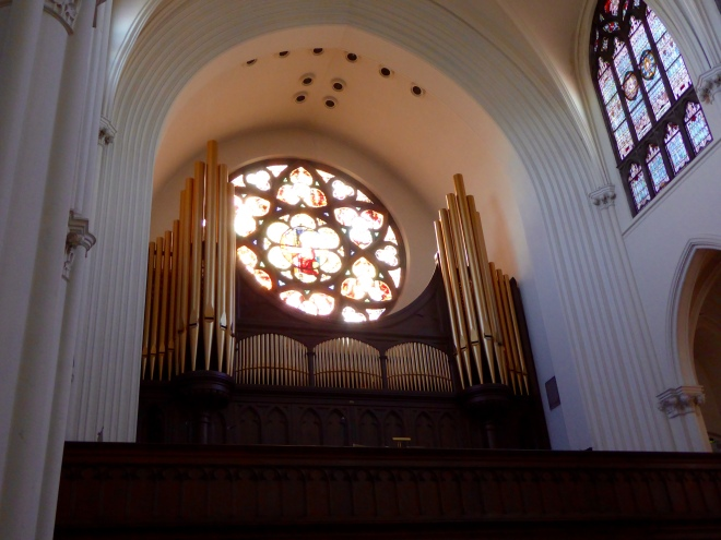 Choir loft with pipe organ and a beautiful window