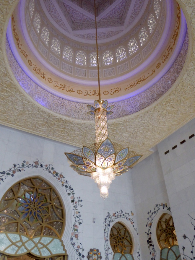 Chandelier hanging from dome